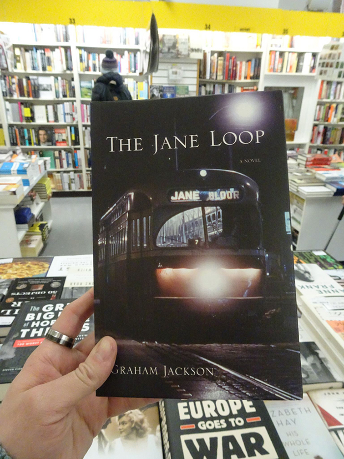 Cover of The Jane Loop by Graham Jackson in a bookstore.